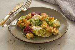 Healthy salad, caesar salad with croutons and dressing. Healthy foods. Healthy salad, caesar salad with croutons and dressing. Healthy food, dinner, bright stock photos