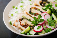 Healthy salad with chicken rolls, radishes, cucumber, green onion and rice Stock Photos