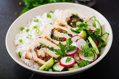 Healthy salad with chicken rolls, radishes, cucumber, green onion and rice Stock Image