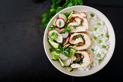 Healthy salad with chicken rolls, radishes, cucumber, green onion and rice Royalty Free Stock Images
