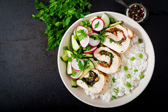 Healthy salad with chicken rolls, radishes, cucumber, green onion and rice. Stock Photo