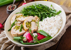 Healthy salad with chicken rolls, radishes, spinach, arugula and ric Royalty Free Stock Image