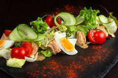 Salad of chicken eggs and tomato. Stock Images