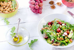Healthy salad with chickpea, grape, walnut  and avocado. Royalty Free Stock Photography