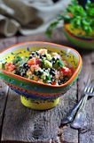 Healthy salad of chickpeas, couscous, black beans with tomato, broccoli, parsley, olive oil and sea salt. Royalty Free Stock Photo