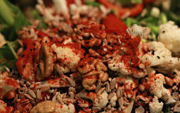Healthy Salad. Comprised of cauliflower, salad, spinach, black seeds, walnuts, paprika, peppers Royalty Free Stock Photo