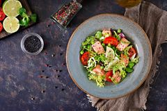 Healthy salad with fish. Baked salmon, tomatoes, lime and lettuce. Healthy dinner. Flat lay. Top view Stock Photography