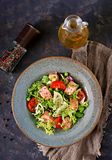Healthy salad with fish. Baked salmon, tomatoes, lime and lettuce. Healthy dinner. Flat lay. Top view Royalty Free Stock Photos