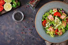 Healthy salad with fish. Baked salmon, tomatoes, lime and lettuce. Healthy dinner. Flat lay. Top view Royalty Free Stock Images