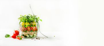 Healthy salad jar with quinoa and vegetables, cherry tomatoes, cucumber, ruccola. Raw vegetarian meal for diet, detox. Clean eating. Homemade concept. Banner Royalty Free Stock Photos