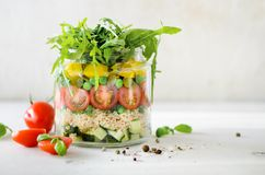 Healthy salad jar with quinoa and vegetables, cherry tomatoes, cucumber, ruccola. Raw vegetarian meal for diet, detox. Clean eating. Homemade concept Royalty Free Stock Image