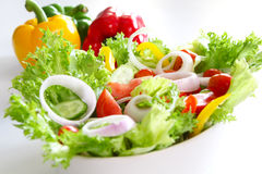 Healthy salad [made of varieties of vegetables]. Healthy salad with wide variesties of veggie and some bell peppers at background Royalty Free Stock Photos