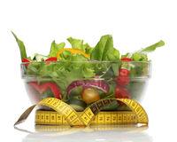 Healthy salad and a measuring tape Stock Photo
