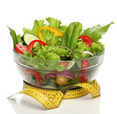 Healthy salad and a measuring tape Royalty Free Stock Images