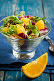Healthy salad mix with orange and walnuts in glass Royalty Free Stock Photography