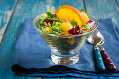 Healthy salad mix with orange and walnuts in glass Royalty Free Stock Image