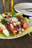 Healthy salad with Octopus and vegetables Stock Photo