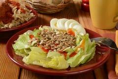 Healthy salad and pasta Stock Photos
