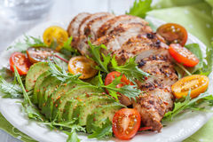 Healthy salad plate with colorful tomatoes, chicken breast and avocado Stock Photography