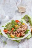 Healthy salad plate with colorful tomatoes, chicken breast and avocado Royalty Free Stock Image