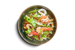 Healthy salad plate. Fresh seafood recipe, shrimps and fresh vegetable salad and hot chili source on traditional dish isolate. Healthy salad plate. Fresh royalty free stock photography