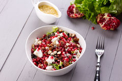 Healthy salad with pomegranate seeds, almond, feta Stock Image