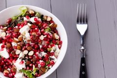 Healthy salad with pomegranate seeds, almond, feta cheese and black rice Royalty Free Stock Images