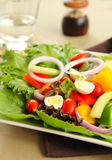 Healthy salad with quail eggs. By a glass and peppermill royalty free stock image