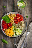Healthy salad with quinoa, chickpeas, avocado, bell pepper, spin Stock Photo