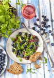 Healthy salad with rocket and blueberries Stock Image