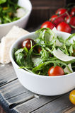Healthy salad with rocket, tomato and parmesan cheese Royalty Free Stock Photo