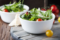 Healthy salad with rocket, tomato and parmesan cheese Royalty Free Stock Photos