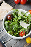 Healthy salad with rocket, tomato and parmesan cheese Royalty Free Stock Image