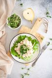 Healthy salad: salmon with pear in a white sauce. Healthy salad idea: salmon with pear in a white sauce on a white plate stock photos