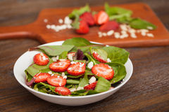 Healthy salad with spinach and strawberries Stock Photos