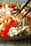 Healthy salad tofu and vegetables with chopsticks macro vertical Stock Images