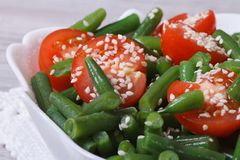 Healthy salad of tomatoes, green beans and sesame Stock Photography