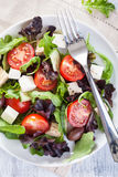 Healthy salad with tomatoes olives and feta cheese Stock Photo