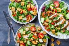 Healthy salads made of hot chicken and fresh stock photography