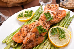 Healthy salmon with coriander. Garnished with asparagus and lemon Stock Image