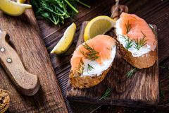 Healthy salmon with cottage cheese on serving board Royalty Free Stock Photos
