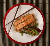 Healthy Salmon Dinner Top View. Top View of Healthy Salmon Dinner on Patterned Placemat Royalty Free Stock Photography