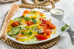 Healthy salmon and fresh vegetables. On white plate Royalty Free Stock Photo