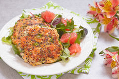Healthy salmon quinoa kale burger. With a green salad Royalty Free Stock Image