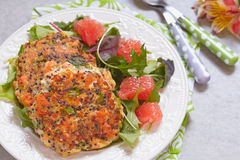 Healthy salmon quinoa kale burger. With a green salad Stock Photography