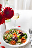 Healthy salmon Salad. Delicious salad with salmon, grapes and cheese on a white background Stock Photo