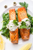 Healthy Salmon Steak on bed of spinach Royalty Free Stock Image