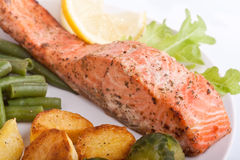Healthy salmon with vegetables. On white plate Stock Photography