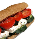Healthy Sandwich. Sandwich in brown baquette with fetta cheese,tomato ,cucumber and olive paste Stock Photos