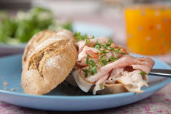 Healthy sandwich. Delicious sandwich with chicken and orange juice Stock Image